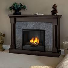 beautiful portable dark walnut gel fuel fireplace with natural stone tiled firebox and solid wood columns