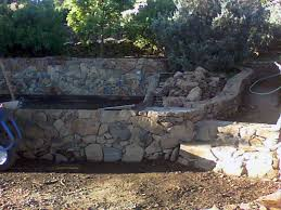 another photo of the rock wall which forms the pond the pond is just behind