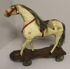 wood horse on platform pull toy iron wheels