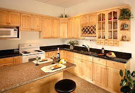 natural maple cabinets with black granite countertops