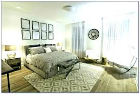 rug underneath bed area rug under bed storage bedroom rug placement guide