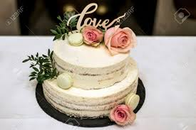 Beautiful Wedding Cake With Cream With Text Love On Top And Pink