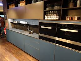 Glass Fronts In Custom Blue Color Features Flush Installed Miele