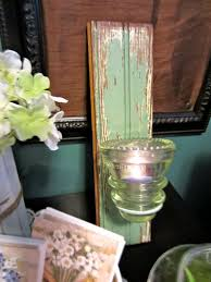 4 wood and glass merged into a vintage retro appealing candle