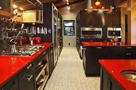 the green undertone in the glass tile back splash goes great with the red of the counter tops second the use of the dark red counter tops with light