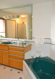 how to update and modernize forest green bathroom fixtures tile carpet countertop and