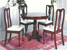 wooden round dining table and 4 high back arm chair in dark cherry finish