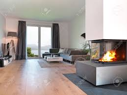 For Living Rooms With Fireplaces Modern Living Room With Fireplace And A View To The Coast Stock