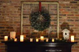 pleasant wreath hang on brick wall panelling also dark wood mantel added candles in fireplace as romantic decorating ideas