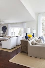 The formal living room is separated into two seating areas, a reading nook  and a