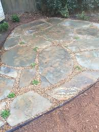 metal edging has been use to maintain the edge with the grass and rose bed on either side
