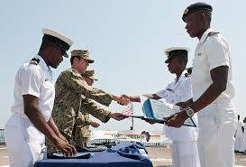 intelligence specialist 3rd class jordan thomas presents a certificate to a ghanaian navy sailor during a graduation ceremony aboard the high speed vessel navy intelligence specialist