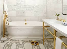 hotel bathroom fixtures. Greenwich Hotel Brass Fixtures In A Marble Bathroom With Freestanding Tub