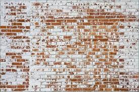 old brick wall with ling white paint