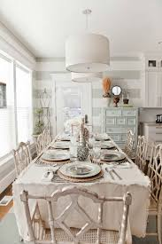 modern meets shabby chic in this elegant dining room rusic chairs wooden tableware really add charm