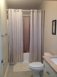 hanging shower curtains to make small bathroom look bigger
