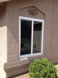 example of a horizontal sliding vinyl window on a frame stucco home