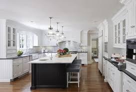 white kitchen with black beadboard island