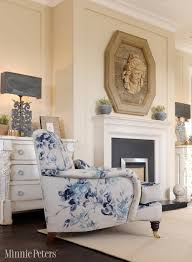 Cream and white color living room; chair; fireplace; lamp | Interior  Designer: