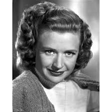 Priscilla Lane on a Knitted Top and Smirking Photo Print - Overstock -  25376882