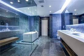 modern bathroom with dark quartz tile glass shower and acrylic bathtub