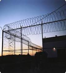 barbed wire fence prison. Prison-fence-and-barbed-wire.jpg Barbed Wire Fence Prison E
