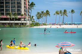 the calm tropical lagoon provides water sports for young travelers