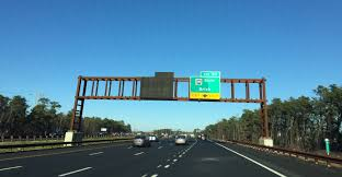 signage for the future herbertsville exit on the garden state parkway covered up