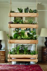 above shallow terra cotta planters and dishes hang from rope to create a wall garden or a window blind their narrow profile planters are only 8
