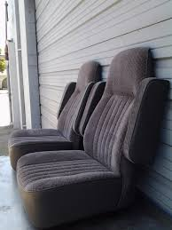 you recieve two 2 universal van captains chairs with youre choise of color in vinyl or clothy leather is extra and so is installation