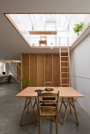 designed by yo shimada of tato architects the main part of the home is partially sunken in the ground which includes the kitchen living room
