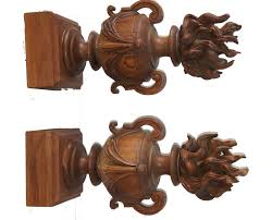 a matched pair of carved wood finials size base 8 75 and they are 25 tall condition the flames were attached to another object and were used in an