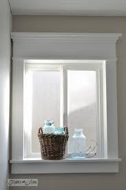 make a farmhouse window add window trim to beef up a plain window with no