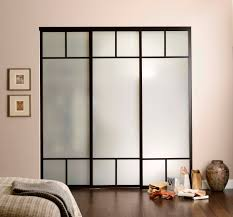 opaque glass wardrobe sliding doors with black wooden frame and pink wall interior color decorating ideas