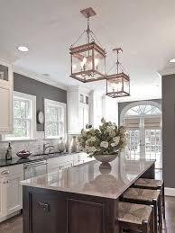modern white and gray kitchen with lanterns
