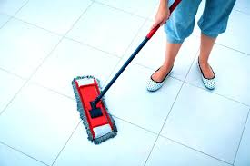 best mop for tile floors and grout woman mopping floor best way to clean tile floors