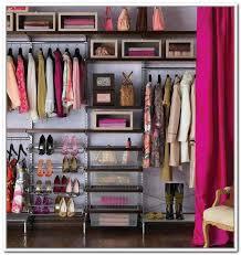 minimalist dressing room with creative clothing storage closet ideas dark brown wooden wall closet ideas
