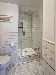 white tiled shower stalls with seats and glass door in the corner bathroom spaces ideas