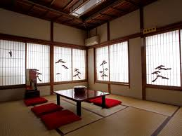 Traditional Japanese guest room. The round container on the table holds a  Japanese tea set
