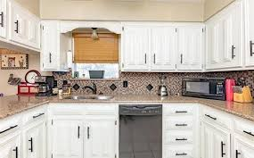 photo 12 of 33 updated kitchen with quartz countertops tile backsplash fixtures and