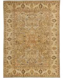 a tan rug carpet available through david e adler inc oriental rugs
