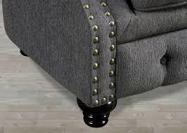 traditional gray fabric sofa with nailhead trim