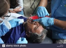 jax baylosis 185th dental company garden grove ca performs a tooth extraction at a medical readiness site in san pablo guatemala may 11 2016