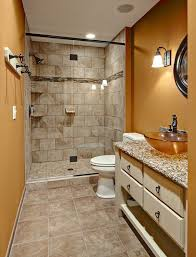 traditional bathroom lighting ideas white free standin. Home Goods Bathroom Rugs With Traditional And Lighting Earth Tone Colors Floor Tile Freestanding Vanity Glass Shower Door Golden Walls Ideas White Free Standin B