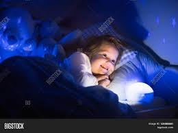 Night Stars Bedroom Lamp Little Girl Reading A Book In Bed Dark Bedroom With Night Light