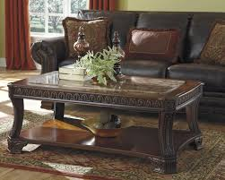 discontinued ashley furniture ledelle 3pc coffee table set to enlarge