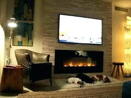 tv mounted on fireplace wall mount fireplace with electric and how to prevent unit designs tv