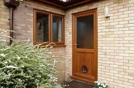golden oak upvc back door with cat flap and casement windows