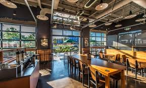 Impressive Glass Garage Doors Restaurant Starbucks Assembly Row Timberline Construction Corporation For Inspiration