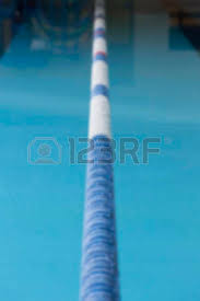 swimming pool lane lines background. Unfoused Closeup Of A Lane Marker Buoy In Indoor Swimming Pool Useful As Background Lines